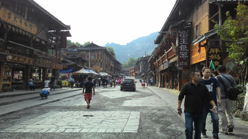 village street with stores on both sides
